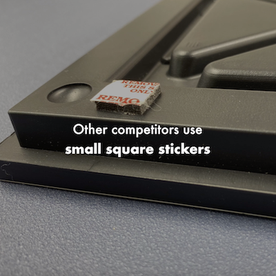 Competitor's tiles are heavier and use small square sticker. More prone to falling