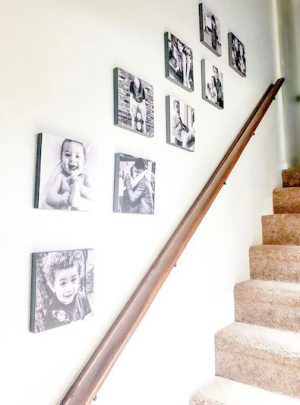 Stick photo tiles on your stairway.
